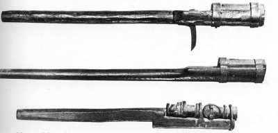 [3 early example handguns]